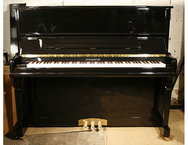 A brand new Steinhoven HG-128T upright piano with a black case and polyester finish