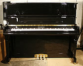 Piano for sale. A brand new Steinhoven upright piano with a black case.