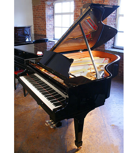 A Brand new Steinway Model A grand piano with a black case