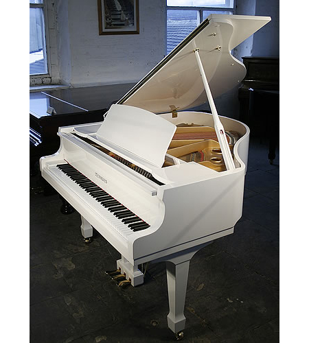 A brand new Steinhoven Model 148 baby grand piano with a white case and polyester finish