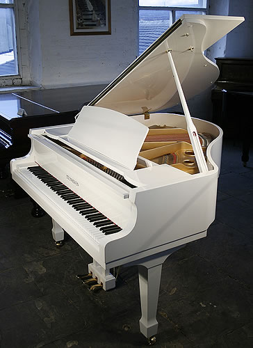 White, Steinhoven Model 148 baby grand Piano for sale.