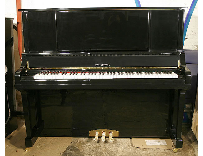A brand new Steinhoven HG-133T-R upright piano with a black case and polyester finish