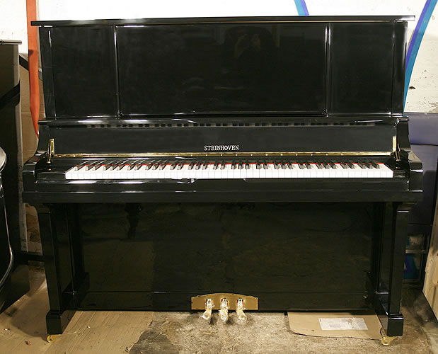 A brand new Steinhoven upright piano with a black case