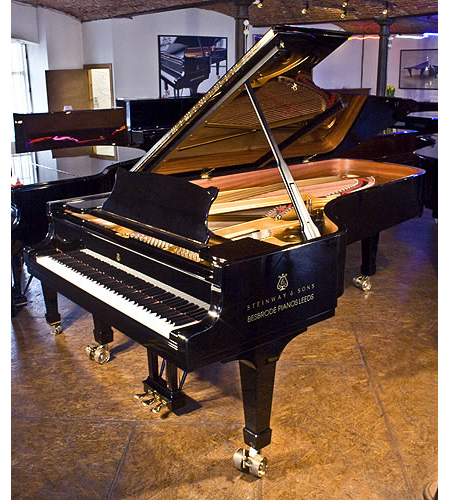 A Steinway Model D concert grand piano with a black case
