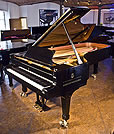 Piano for sale. A Steinway Model D concert grand piano with a black case.
