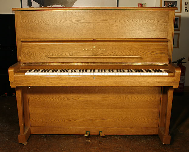 Steinway Model K upright Piano for sale with an oak case.