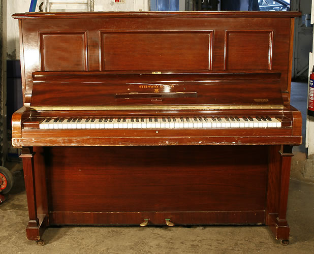 Steinway Model K upright Piano for sale with an mahogany case.