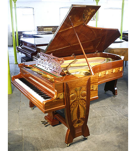 A stunning, Bechstein Model C grand piano with a french polished, beautiful mahogany case inlaid with a variety of woods in an Art Nouveau design of flowers and tendrils