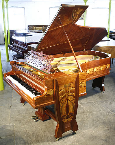 A stunning, Bechstein Model C grand piano with a french polished, beautiful mahogany case inlaid with a variety of woods in an Art Nouveau design of flowers and tendrils. This piano had one previous owner Julius Gutermann, a wealthy victorian industrialist.