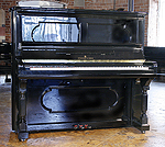 An antique Steinway upright piano with a black case.