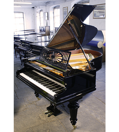 A restored, 1911,  Bechstein Model A grand piano with a polished, black case