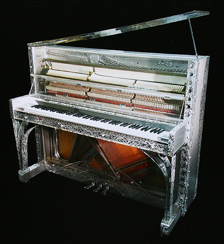 A Gary Pons SY123 upright piano with a transparent, Altuglass and embossed, stainless steel case