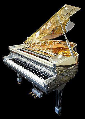 """杰瑞庞斯(Gary Pons)型号 SY170 三角钢琴,使用特殊透明材质,安装有LED灯,可以通过外壳看到内部击弦机的结构与活动原理,这架钢琴来自于""""Plexart""""展会,每一架都有单独的编号,并且由设计者签名,外壳有多种造型可供选择,每台琴的LED设计均是独一无二的艺术设计,提供订购服务"""