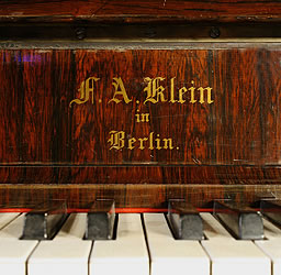 Klein Lyre piano  manufacturers logo on fall