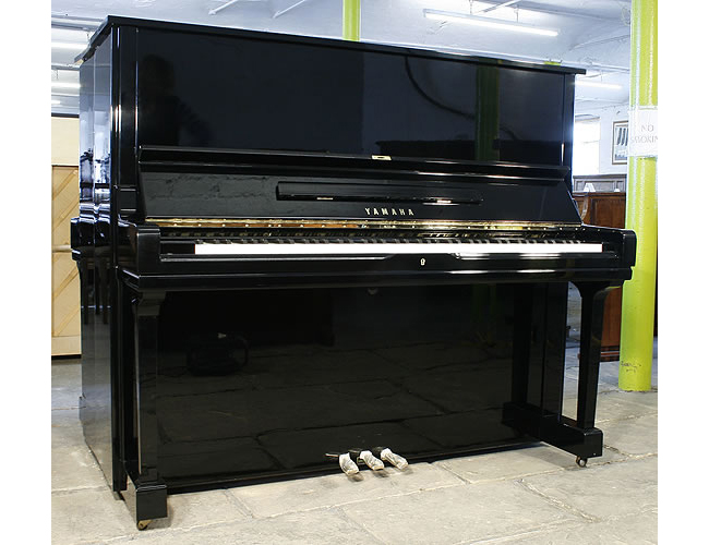 A  Yamaha U3 upright piano with a black case and polyester finish