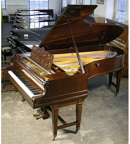 A 1912, Bechstein Model D grand piano with a polished, mahogany case, gate legs and filigree music desk