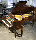 Piano for sale. A Bechstein Model D grand piano with a mahogany case.