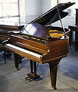 A Bechstein Model S grand piano with a polished, mahogany case. 