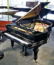Piano for sale. A restored,  Berdux grand piano with a polished, black case