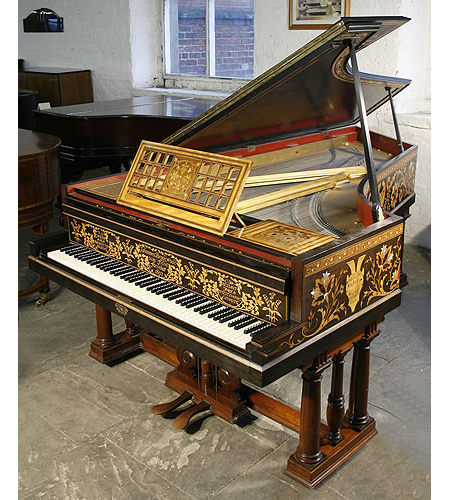 A stunning, Broadwood grand piano with an intricately inlaid case. Designed by T G Jackson and inlaid by C H Bessant Faber. Made for Athelstan Riley's Music Gallery at 2 Kensington Court London in 1892