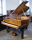 A Steinway Model A grand piano with a burr walnut case. 