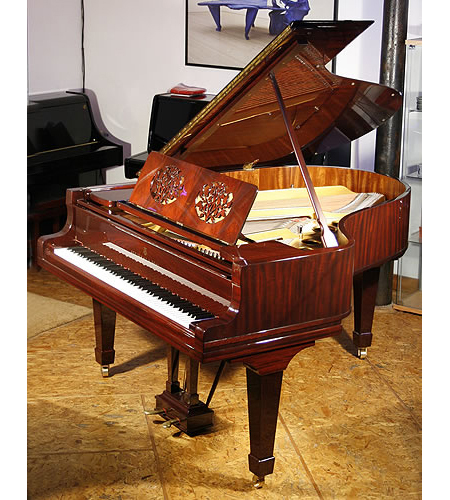 A 1921, Steinway Model O grand piano with a rosewood case and cut-out music desk in a foliage design