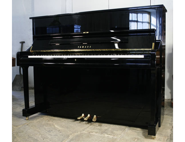 A Yamaha U1 upright piano with a black case and polyester finish