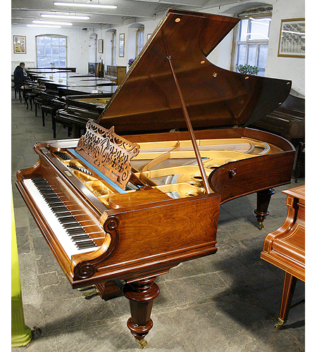 An 1885, Bechstein Model D grand piano with a polished, rosewood case and turned legs