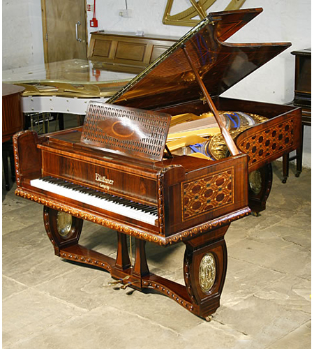 A unique, 1910 Bluthner grand piano with a Jacaranda case with intricate marquetry inlay. all over case in a variety of designs and woods