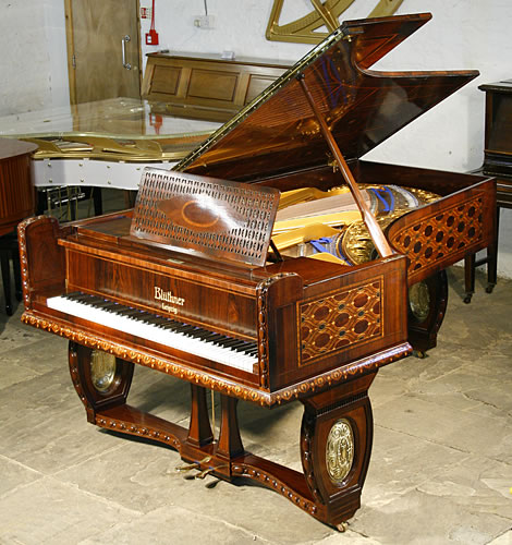 A unique, Bluthner grand piano with a Jacaranda case with intricate marquetry inlay. all over case in a variety of designs and woods