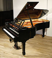 A brand new, Feurich model 218 concert grand piano with a black case and brass fittings.