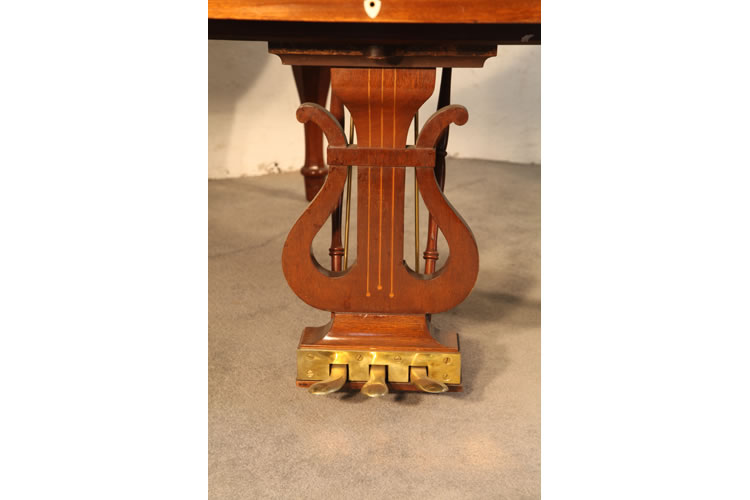 Steinway piano lyre in the classic lyre shape with stringing inlay. Piano has three pedals and a brass footplate
