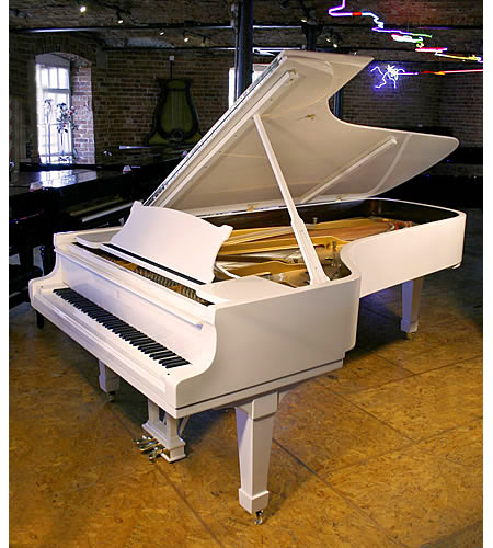 A Steinway Model D concert grand piano with a white case and polyester finish
