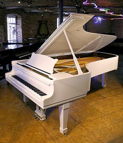 A Steinway Model D concert grand piano with a white case