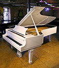Piano for sale. A Steinway Model D concert grand piano with a white case.