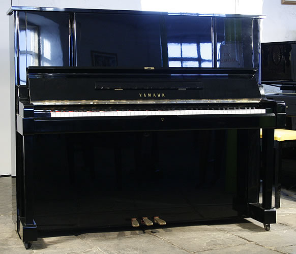 Yamaha YUX upright Piano for sale.