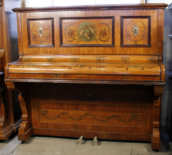 A Payne upright piano with a  hand-painted satinwood case