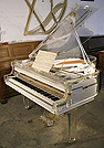 Piano for sale. A brand new Steinhoven  grand piano with a transparent, acrylic case.