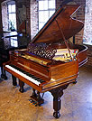 An antique, Steinway Model A grand piano with a polished, rosewood case. 