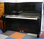 A Bechstein model 8 upright piano with a black case. 