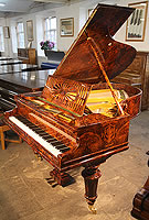 A 1910, Bechstein Model A grand piano with an exquisite, burr walnut case.