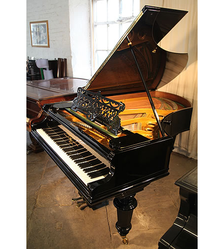 A restored, antique, 1896, Bechstein Model V grand piano with a polished, black case