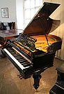 An 1896, Bechstein Model V grand piano with a polished, black case. 