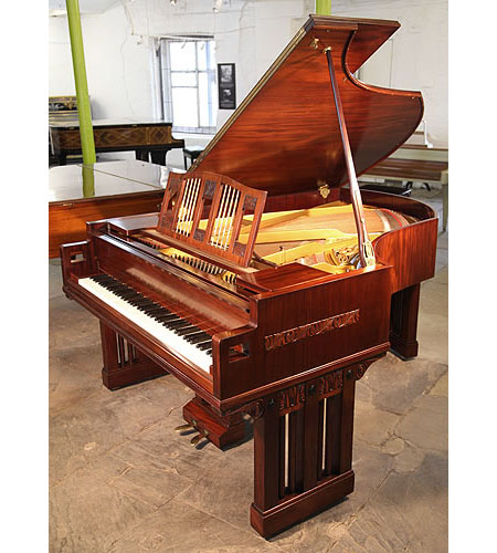 An Arts and Crafts, 1916, Ibach grand piano with a polished, mahogany case. Designed by Dutch Architect Pierre Joseph Hubert Cuypers, famous for designing the Rijksmuseum and Central Station in Amsterdam