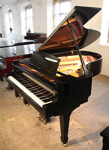 Miki model 5 grand piano for sale with a black case and for Big grand piano