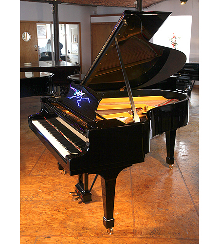 A 1926, Steinway Model O grand piano with a black case and spade legs