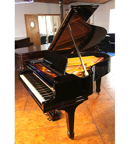 A 1910, Steinway Model O grand piano with a black case and spade legs