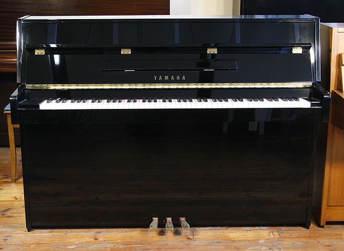 Yamaha C108 upright Piano for sale with a black case and polyester finish