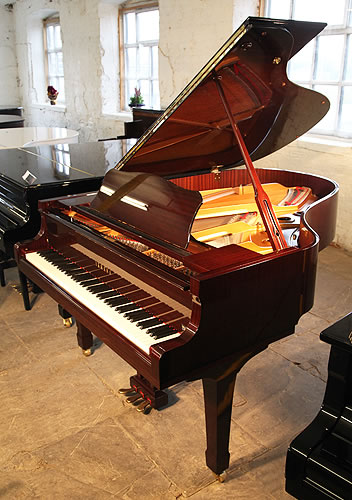 a 1995 yamaha c3 grand piano for sale with a mahogany
