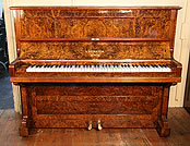 An antique Bechstein upright piano with a beautiful, burr walnut case